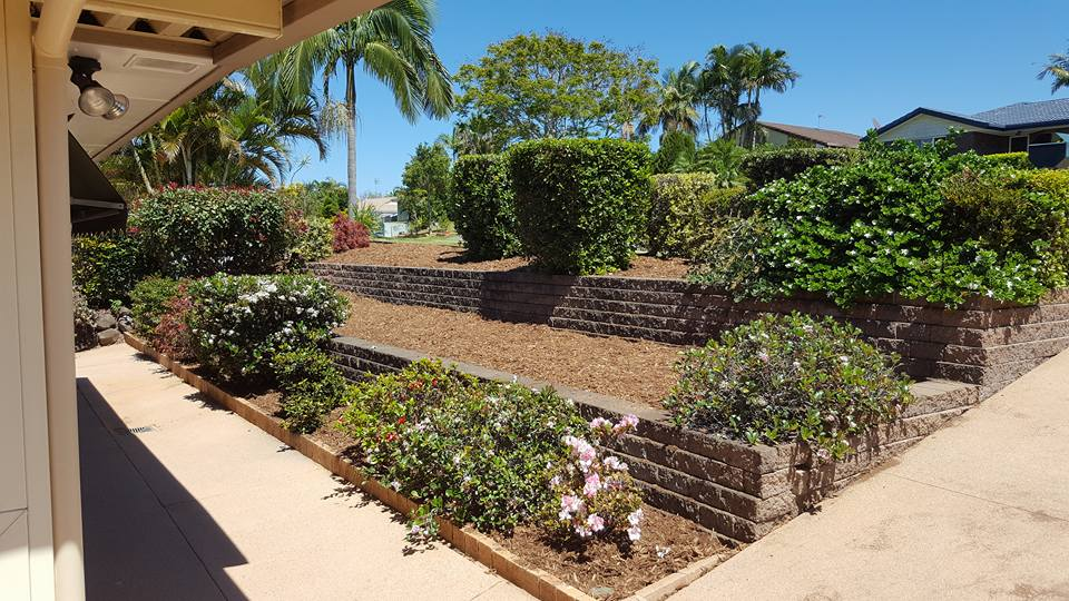 sloped yard tiered retaining walls northern gold coast landscaper